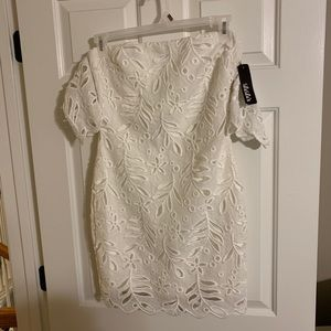 Off shoulder fitted white lace mini dress